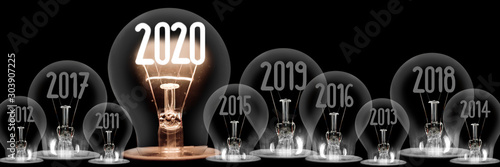 Obraz na plátne  Light Bulbs with New Year 2020 Concept