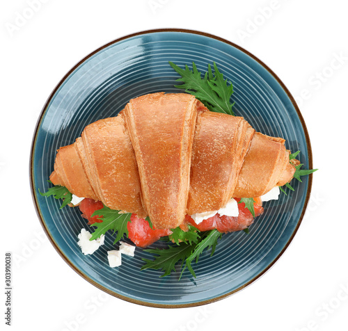 Fototapeta  Plate with tasty croissant sandwich isolated on white, top view