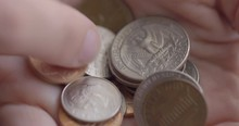 Detail Of Caucasian Woman's Finger Sorting Through A Hand Full Of Assorted United States Coins With Heads And Tails Up. Macro Close-up With Shallow Focus And Soft Daylight Lighting, Recorded At 60fps