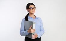 Businesswoman Holding Folder Standing Smiling On White Background