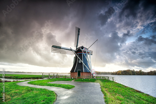 dark-dramatic-rainy-cloud-over-dutch-windmill