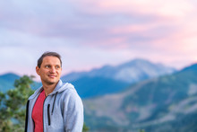 Aspen, Colorado Mountains Colorful Purple Blue Twilight Sunset Blurry Background View And Happy Young Man Standing Looking