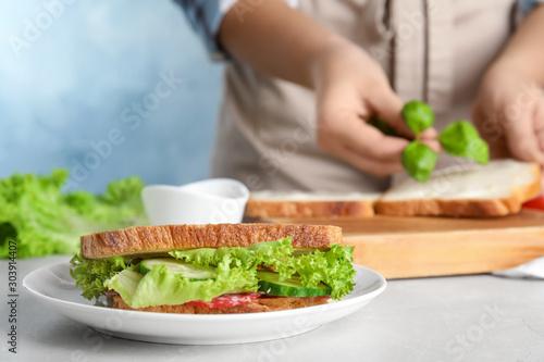 Fotografía  Tasty sandwich on light grey marble table, closeup