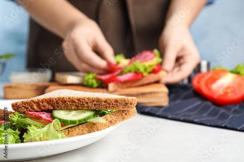 Cuadros en Lienzo Tasty sandwich on light grey table, closeup