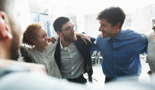 Happy Businesspeople Bonding In Circle At Company Seminar