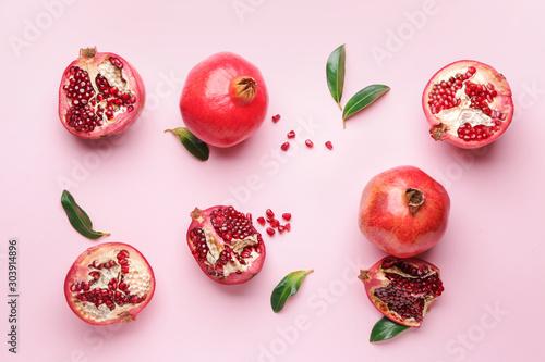 Obraz na plátně Ripe juicy pomegranates on color background