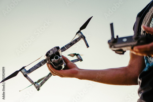 Drone in army camouflage skin. Canvas Print
