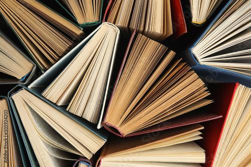 Many different hardcover books on dark background, top view Billede på lærred