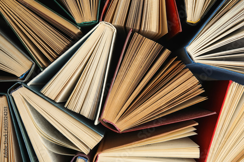Obraz Many different hardcover books on dark background, top view - fototapety do salonu