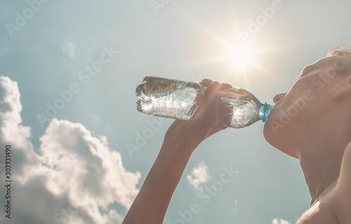 Cuadros en Lienzo Female portrait drinking bottle water.