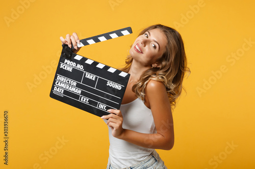 Cheerful young woman girl in light casual clothes posing isolated on yellow o...