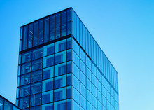 Glass Business Office Building Architecture Of Modern City In Salzburg In Austria. Urban Corporate Skyscraper Exterior And Skyline. Blue Windows Design