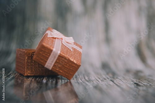 Christmas background. Gift box with ribbon.