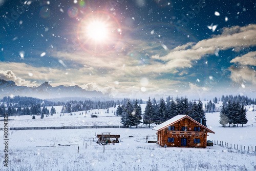 Foto auf AluDibond Blaue Nacht Fairy-tale winter landscape and cottage in woods at winter. Christmas concept.