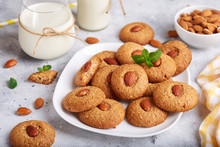 Delicious Homemade Almond Cookies, Served With Glass Of Milk