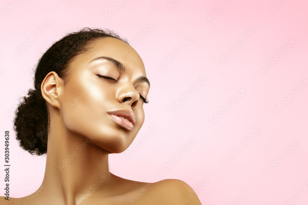 Fototapeta African American skincare models portrait. Beauty spa treatment concept.Young girl posing with closed eyes against pink background