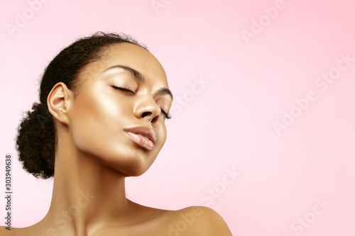 Garden Poster Spa African American skincare models portrait. Beauty spa treatment concept.Young girl posing with closed eyes against pink background