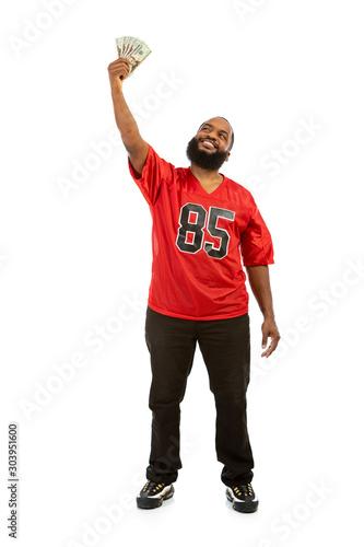 Fényképezés Fan: Man In Football Jersey Holds Aloft Money Fan