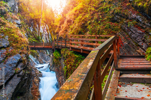 Beautiful Wimbachklamm gorge with wooden path in autumn colors, Ramsau bei Berch Canvas Print