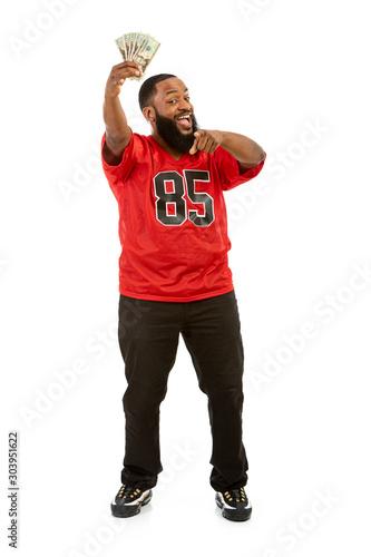 Vászonkép Fan: Man In Football Jersey Holds Aloft Money Fan