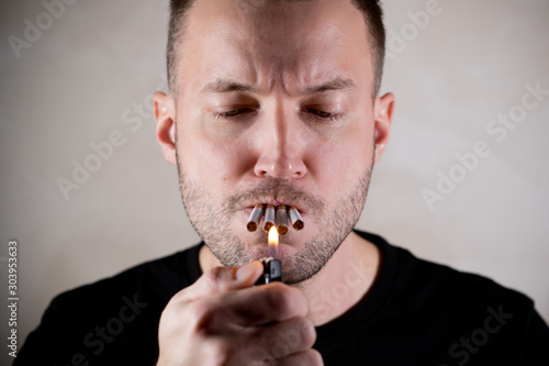 Vászonkép  funny man lights four cigarettes at once
