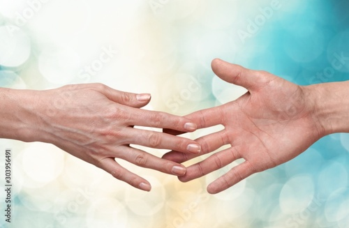 Obraz Female and male hands holding each other on background - fototapety do salonu