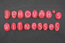 Jehovah's Witnesses, Religion Name Composed With Red And Carved Stone Letters Over Black Sand