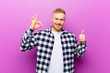 canvas print picture - young blonde man with squared shirt feeling happy, amazed, satisfied and surprised, showing okay and thumbs up gestures, smiling