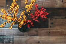 Top View Of Beautiful Yellow And Orange Berries On Rustic Wood Background With Blank Space For Copy