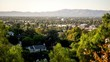 Timelapse sunsetting over valley neighborhood as the mountain shadow streches across the town.