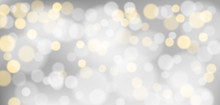 Silver Bokeh Background. Christmas Glowing Silver And Golden Lights With Sparkles. Holiday Decorative Effect.