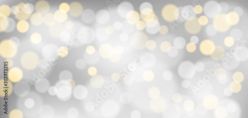 Obraz Silver bokeh background. Christmas glowing silver and golden lights with sparkles. Holiday decorative effect. - fototapety do salonu