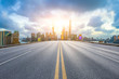 canvas print picture - Empty asphalt highway and modern cityscape in Shanghai at sunset.
