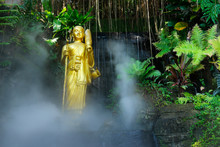 Buddhist Statue In The Forest With Mist In Thailand