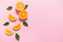 Fresh Orange Pieces On Color Background