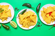canvas print picture - Plates with tasty nachos on color background