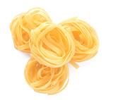 Tasty uncooked pasta on white background