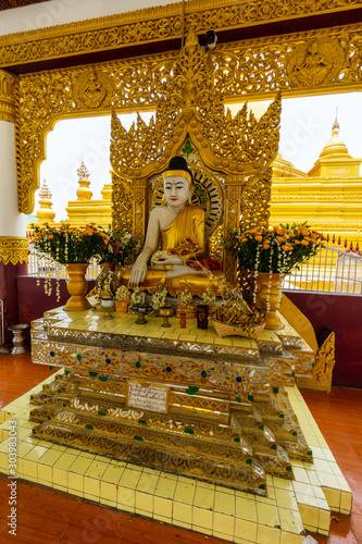 Buddha image at the Kuthodaw Pagoda is a Buddhist stupa, located in Mandalay, Myanmar (formerly Burma).  Travel and tourism.