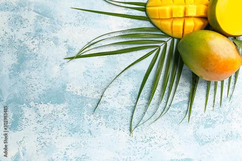 Tasty mango fruit on color background