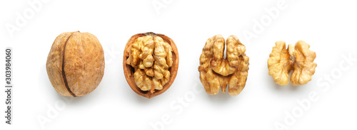 Cuadros en Lienzo  Tasty walnuts isolated on white