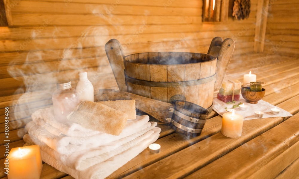 Fototapeta Sauna and sauna accessories on an interior background