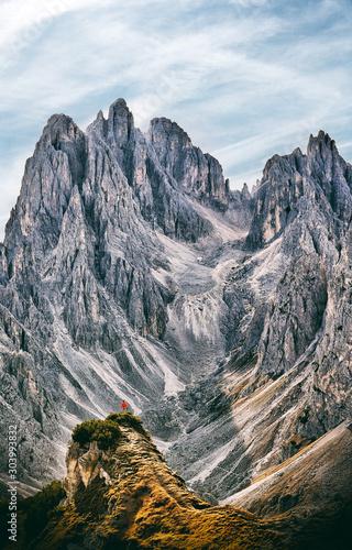 Obraz Minimalistic mountains landscape with man against huge peaks - fototapety do salonu