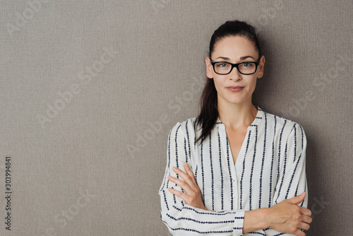 Fotobehang Vrouw gezicht Pert young woman wearing glasses