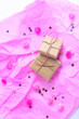 canvas print picture - holiday concept. composition of small boxes in craft paper on a pink background. view from above