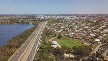Aerial, Busy Freeway Between Residential Suburb And Lake, Perth, Australia