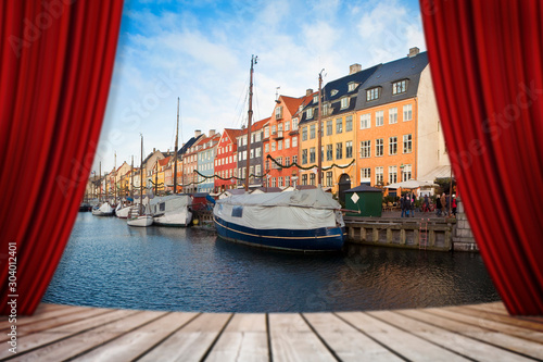 Recess Fitting Magenta Open theater red curtains against Nyhavn city during the Christmas holidays - (Europe - Denmark - Copenhagen) - concept image