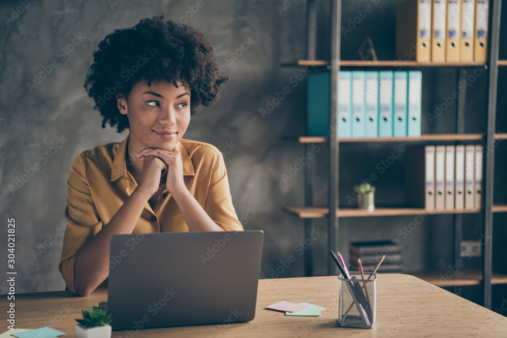 Fototapeta Photo of cheerful cute pretty agent mixed-race having ended working on presentation of her corporation as result of coworking with colleagues