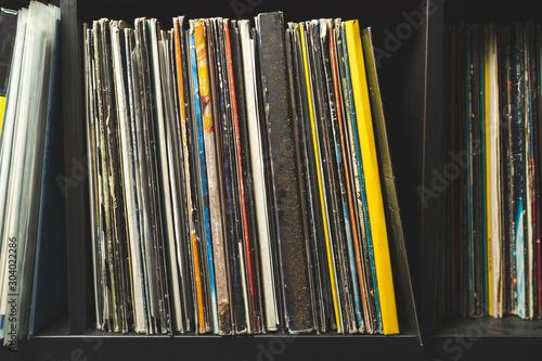 Wooden shelf full of vinyl records - 304022286