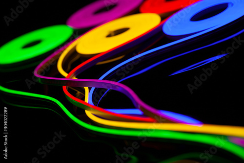 Flexible led tape neon flex in different colors on black background Canvas-taulu