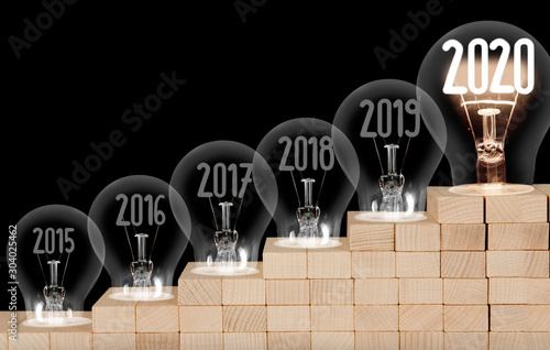 Valokuvatapetti Light Bulbs with New Year 2020